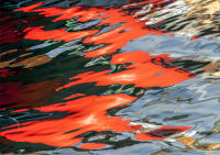 Photograph of Orange Reflections in Water